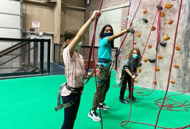 The Cliffs at Valhalla kids learn to rock climb with teacher Top Indoor Play Spaces for Kids in Westchester That Are Open Now
