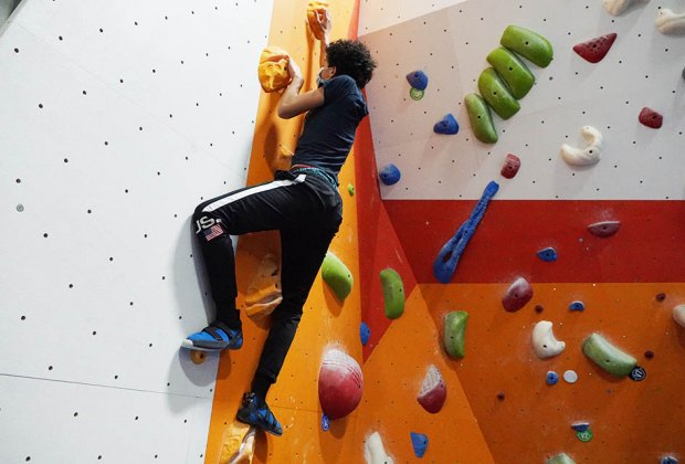 teenager rocking climbing indoors The Cliffs at Harlem