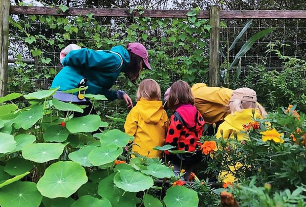 Small children look at the garden at the Queens County Farm Museum