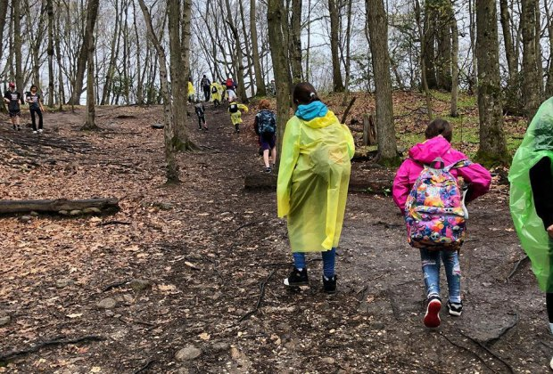 Children hike through the woods at the Theodore Roosevelt Sancutary