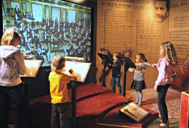 The kids can have a go at conducting the orchestra at Vienna's Haus der Musik. Photo courtesy of Vienna Tourism