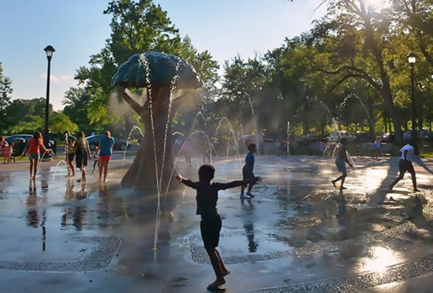 Kids running though sprinklers at Warinaco Park