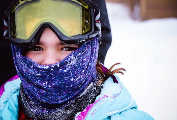 Masks up and jackets zipped! Make sure kids have proper layers for skiing.