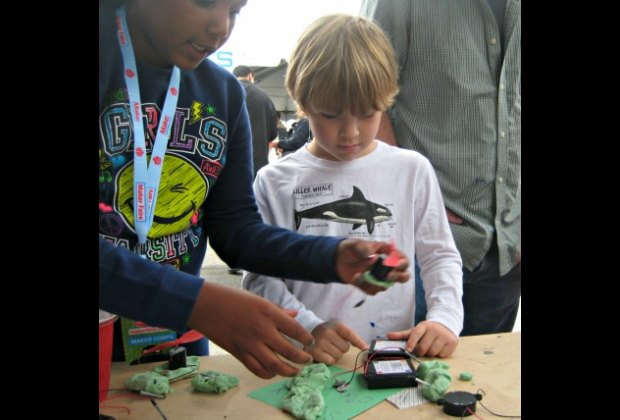 Learning about circuitry from one of the Young Makers