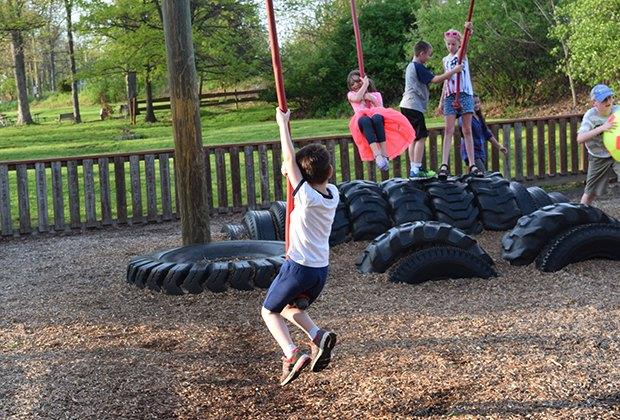 Kids dangle from rope swings at KidStreet