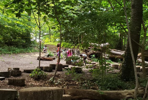 Children play at the Zucker Natural Exploration Area